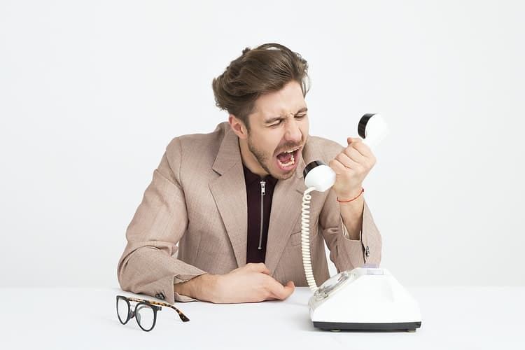 An angry customer screaming on the phone.