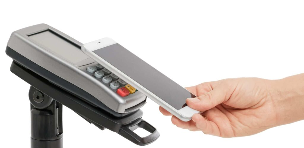 Smartphone being used for contactless payment with NFC technology.